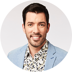 Drew Scott smiling in blue blazer