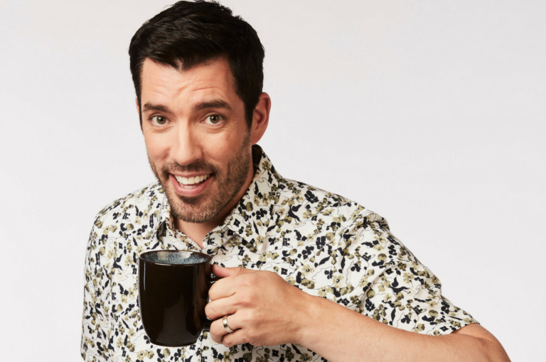 Drew Scott holding mug and smiling