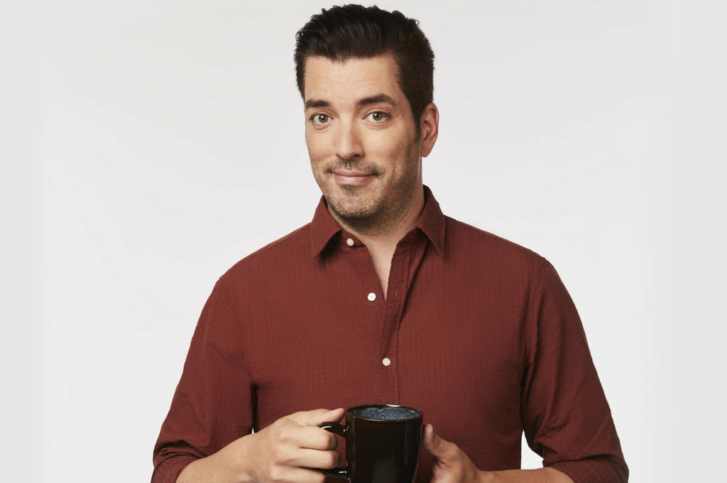 Jonathan Scott smiling with mug