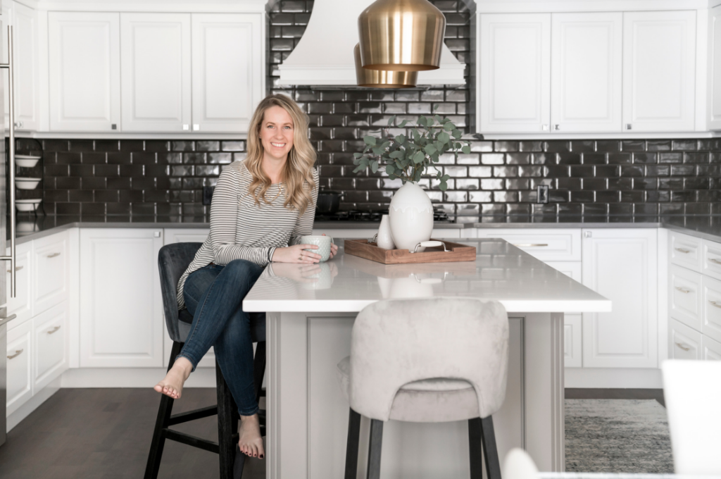 Sarah Sandeman of Gioia Interiors drinking coffee in a kitchen