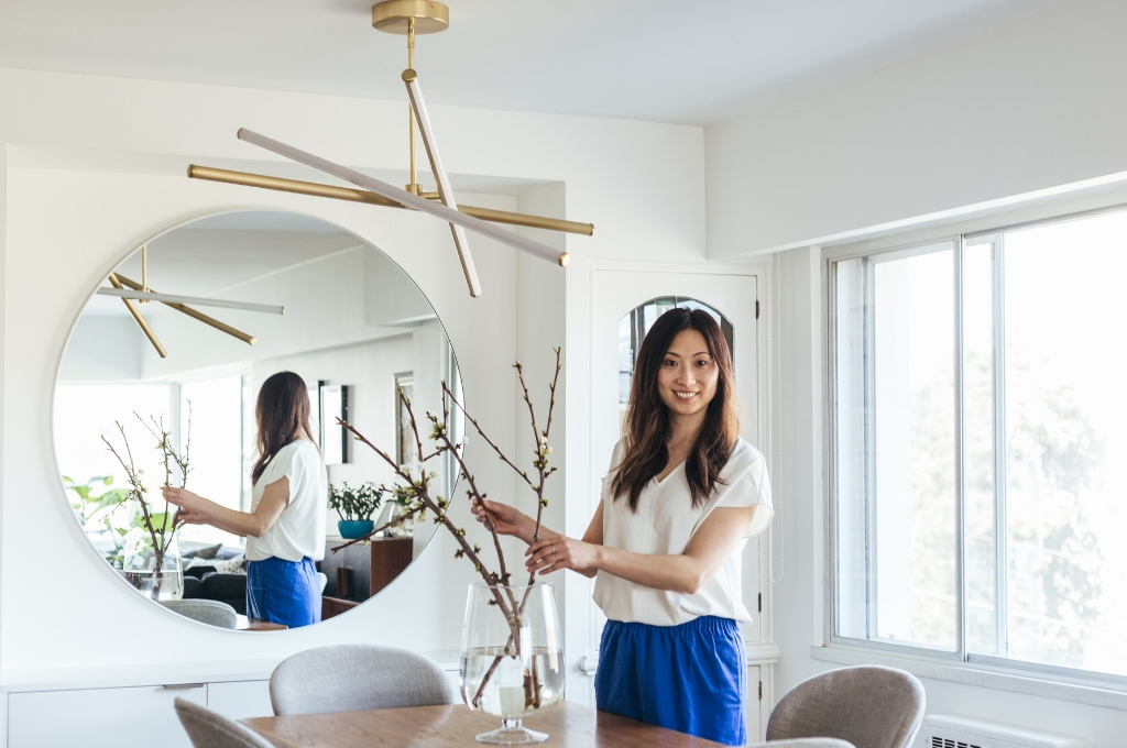 Yumi Murayama of YU+ME Design in a dining room